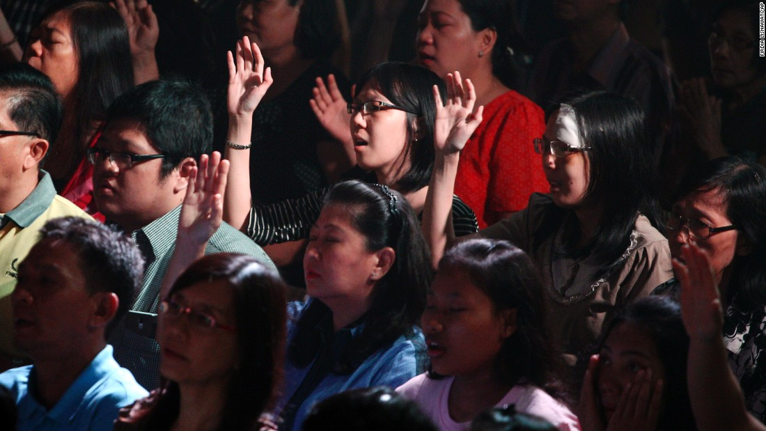 Members of the Mawar Sharon Church attend a prayer service for the relatives of lost loved ones January 4 in Surabaya, Indonesia.