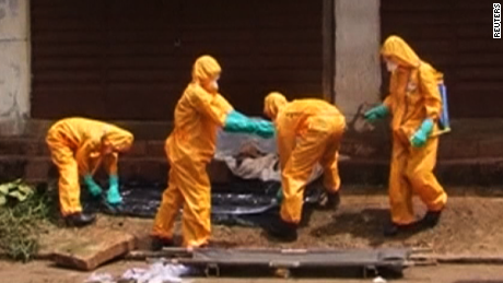Health care workers getting sprayed down in Freetown, Sierra Leone on October 8, 2014
