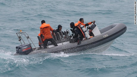 Divers from the National Search And Rescue Agency (BASARNAS) on a rubber boat conduct their search operation for the victims of AirAsia flight QZ 8501at Java Sea, Indonesia, Sunday, Jan. 4, 2015. D