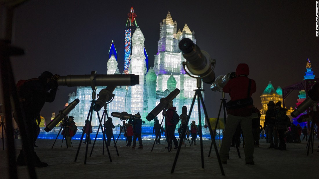 Visitors can use telescopes to get a better look at the ice sculptures.