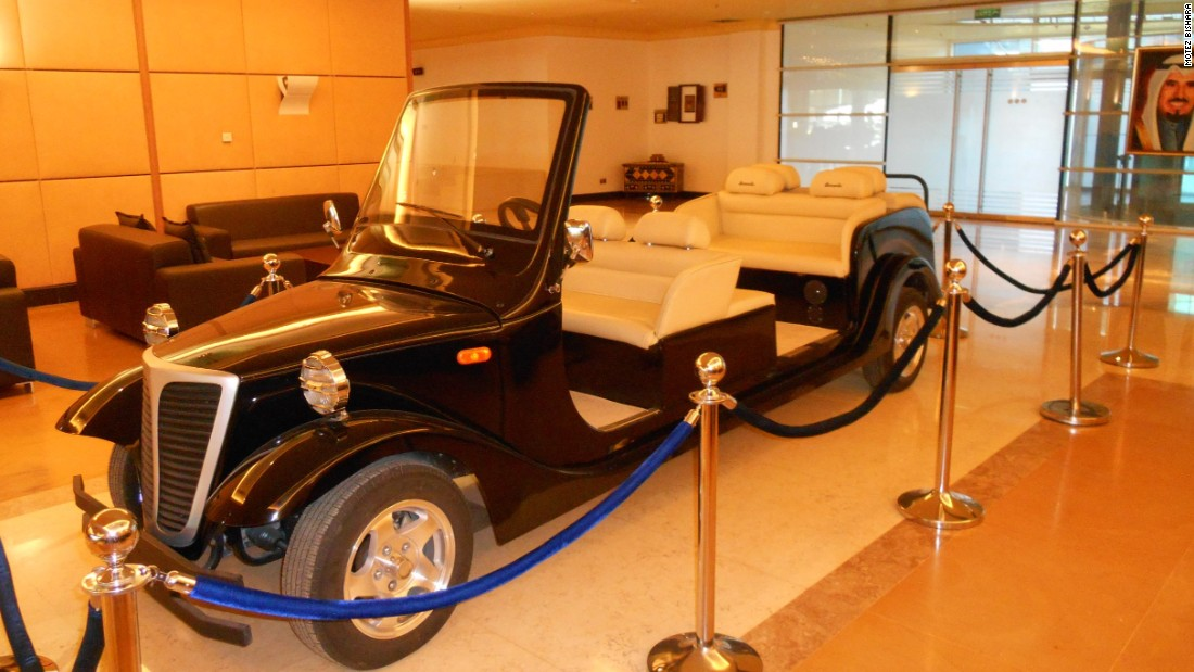 Parked inside the stadium is a custom-made golf cart delivered from the United States. It was made specially to drive the Emir of Kuwait, Sheikh Sabah Al-Ahmad Al-Sabah, and other dignitaries onto the pitch in the event of special occasions. A portrait of the stadium's honoree, the late Sheikh Jaber Al-Ahmad Al-Sabah, hangs in the background.