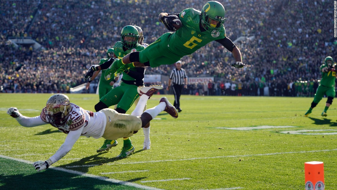 Oregon wide receiver Charles Nelson leaps over Florida State's Nate Andrews during the Rose Bowl, which was played Thursday, January 1, in Pasadena, California. Oregon beat the defending national champions 59-20 in what was the first game of the new College Football Playoff. The Ducks will play Ohio State in the title game on January 12.