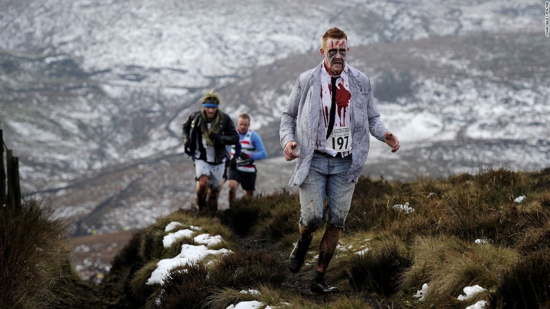 Costumed runners cross the Pennine hills near Naworth, England, during the traditional Auld Lang Syne race on Wednesday, December 31.