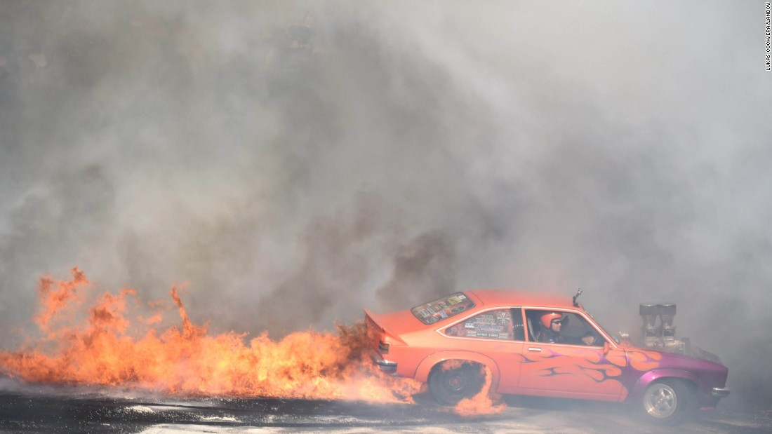 A car catches fire while performing a burnout Saturday, January 3, at the Summernats car festival in Canberra, Australia.