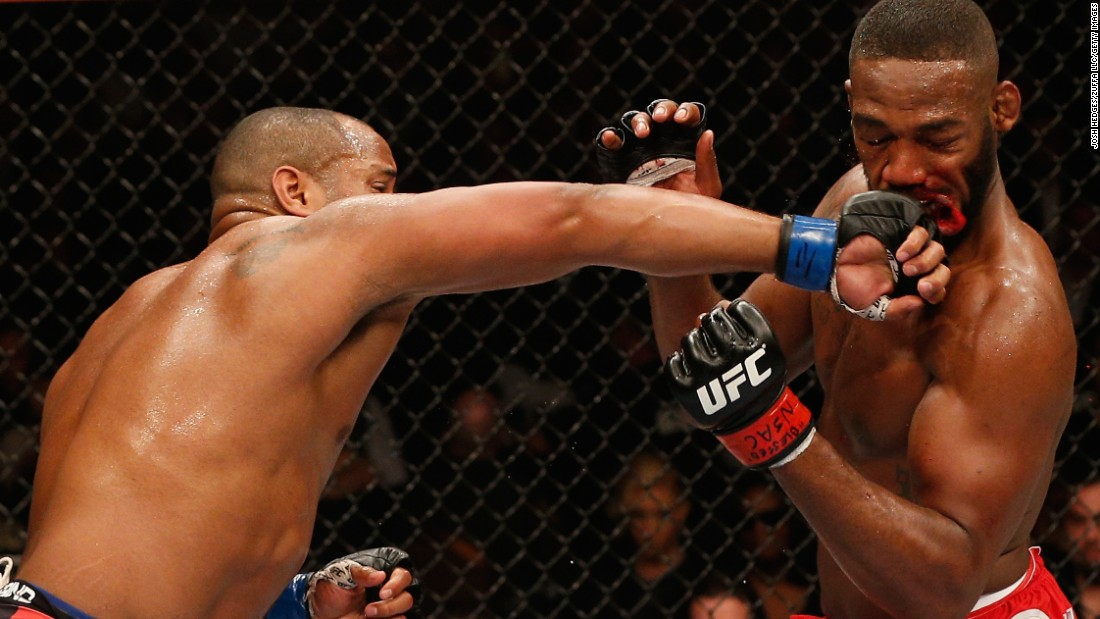Daniel Cormier punches UFC champion Jon Jones during their title fight Saturday, January 3, in Las Vegas. Jones won by unanimous decision, however, to retain his light-heavyweight crown.
