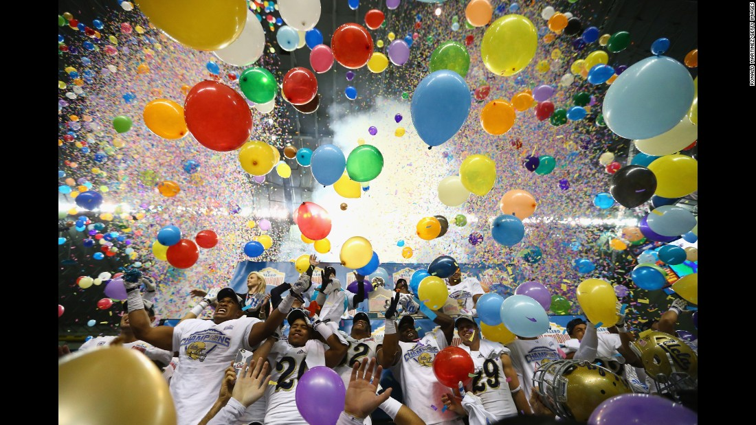 The UCLA football team celebrates after winning the Alamo Bowl, which was played in San Antonio on Friday, January 2. The Bruins defeated Kansas State 40-35 to finish their season with a 10-3 record.