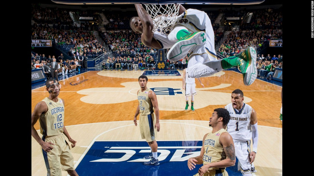 "<a href=""http://bleacherreport.com/articles/2318213-notre-dames-jerian-grant-rises-up-for-emphatic-slam-dunk-vs-georgia-tech"" target=""_blank"">Dunk of the year so far?</a> Notre Dame guard Jerian Grant hangs onto the rim after throwing one down against Georgia Tech on Saturday, January 3."