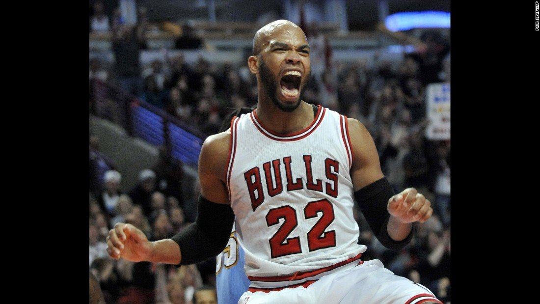Chicago's Taj Gibson celebrates a dunk during an NBA game against Denver on Thursday, January 1.