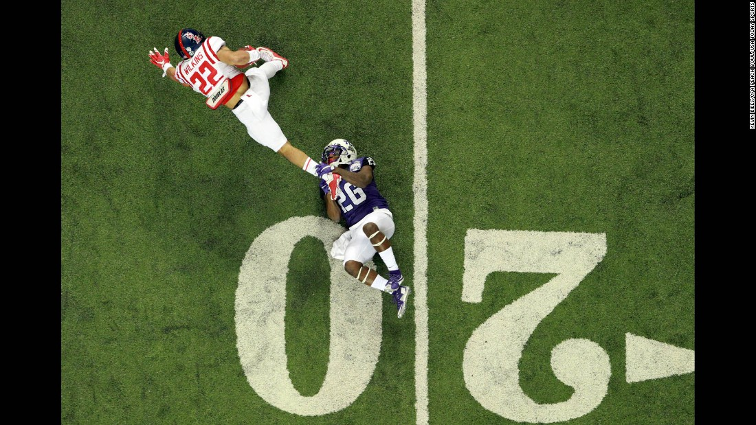 TCU safety Derrick Kindred tackles Ole Miss running back Jordan Wilkins during the Peach Bowl, which was played in Atlanta on Wednesday, December 31. TCU dominated the Rebels 42-3 and finished the season with a 12-1 record.