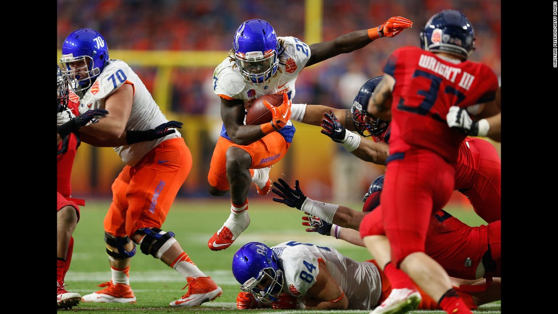 Boise State running back Jay Ajayi skips past Arizona defenders during the Fiesta Bowl, which took place Wednesday, December 31, in Glendale, Arizona. Ajayi had 134 yards and three touchdowns to help the Broncos win 38-30.