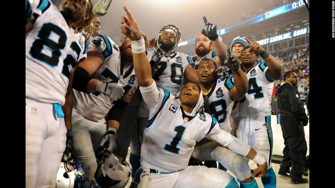 Some of the Carolina Panthers, including quarterback Cam Newton (No. 1), celebrate together after their playoff victory Saturday, January 3, in Charlotte, North Carolina. The Panthers beat the Arizona Cardinals 27-16 to advance to the next round.