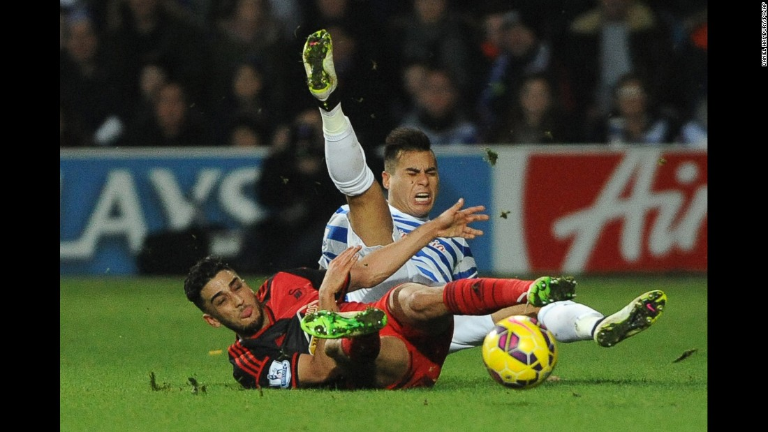 QPR defender Mauricio Isla, right, is tackled by Swansea City's Neil Taylor during a Premier League match played in London on Thursday, January 1.