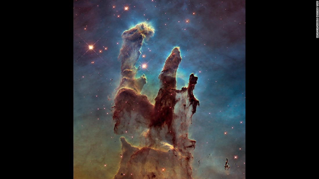 "NASA has captured a stunning new image of the so-called ""Pillars of Creation,"" one of the space agency's most iconic discoveries. The giant columns of cold gas, in a small region of the Eagle Nebula, were popularized by a similar image taken by the Hubble Space Telescope in 1995."