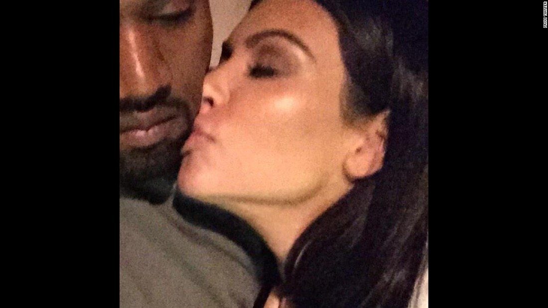 "Television personality Kim Kardashian kisses her husband, rapper Kanye West, in this selfie <a href=""https://twitter.com/KimKardashian/status/551264115411279872/photo/1"" target=""_blank"">she tweeted</a> Friday, January 2. ""Good night,"" she wrote."