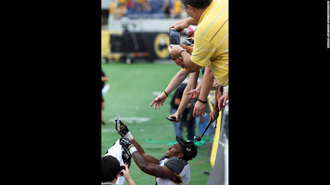 Missouri running back Marcus Murphy takes a selfie with fans on Thursday, January 1, after his team defeated Minnesota at the Citrus Bowl in Orlando, Florida.