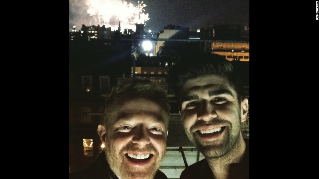 """Happy New Years from London!"" wrote actor Jesse Tyler Ferguson as he posted this selfie with his husband, Justin Mikita."