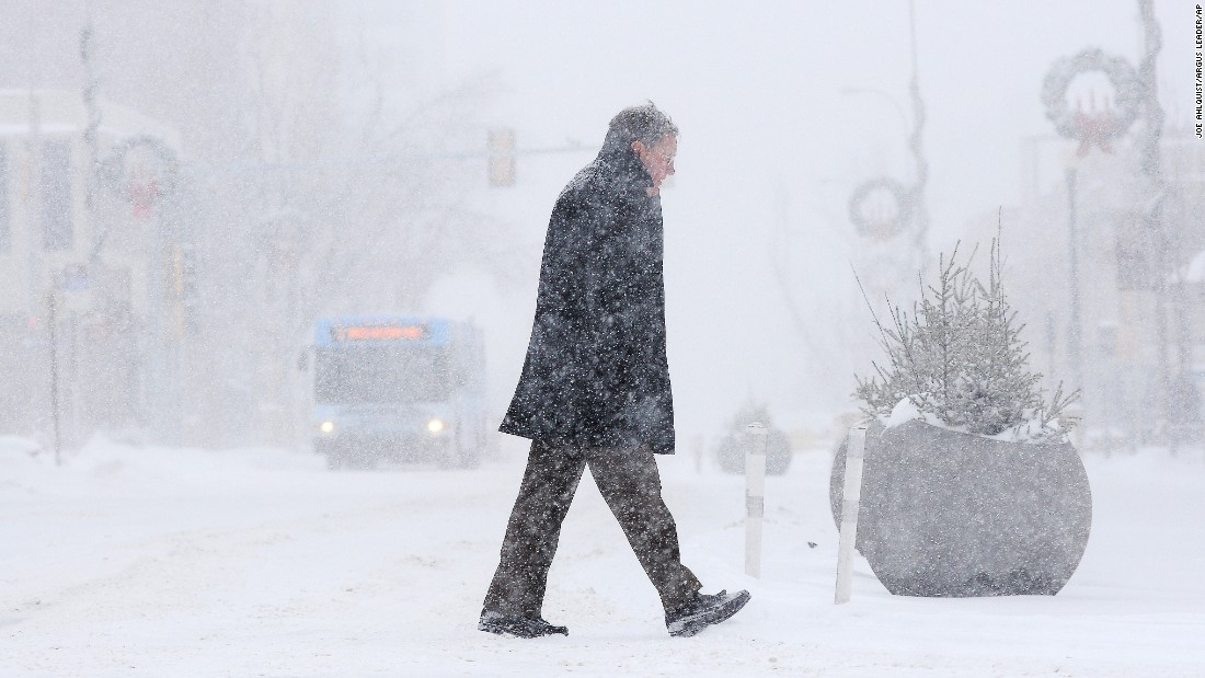 Bill Taylor walks to work during a winter storm on January 5, in Sioux Falls, South Dakota.