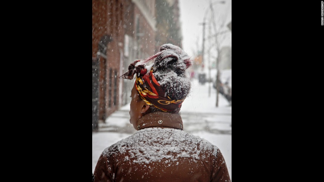 Snow partially covers a pedestrian on January 6 in the Bronx, New York.