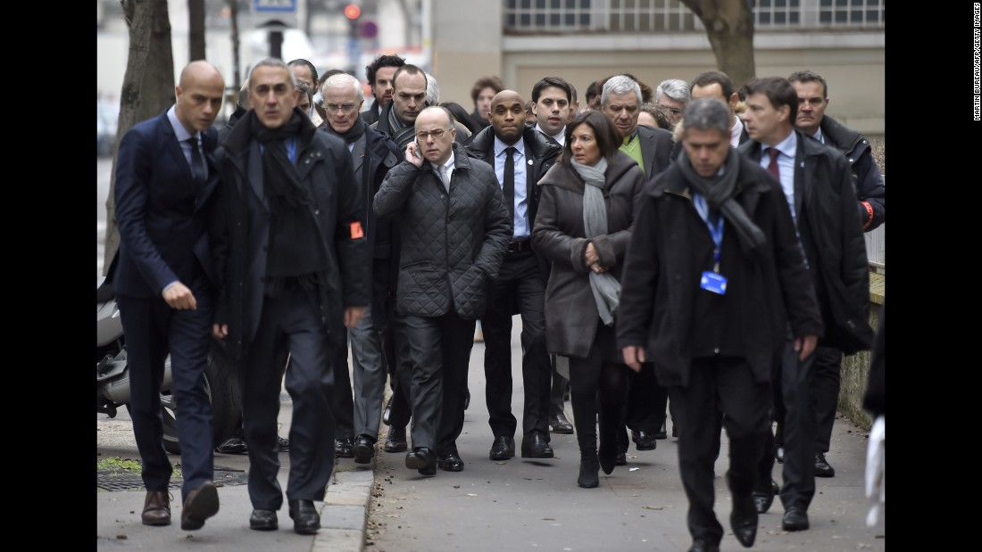 Paris Mayor Anne Hidalgo and Interior Minister Bernard Cazeneuve arrive at the scene.