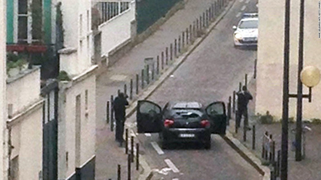 Gunmen face off with police officers in Paris on Wednesday, January 7. A terrorist attack at the Paris office of Charlie Hebdo, a French satirical magazine, left at least 12 people dead.