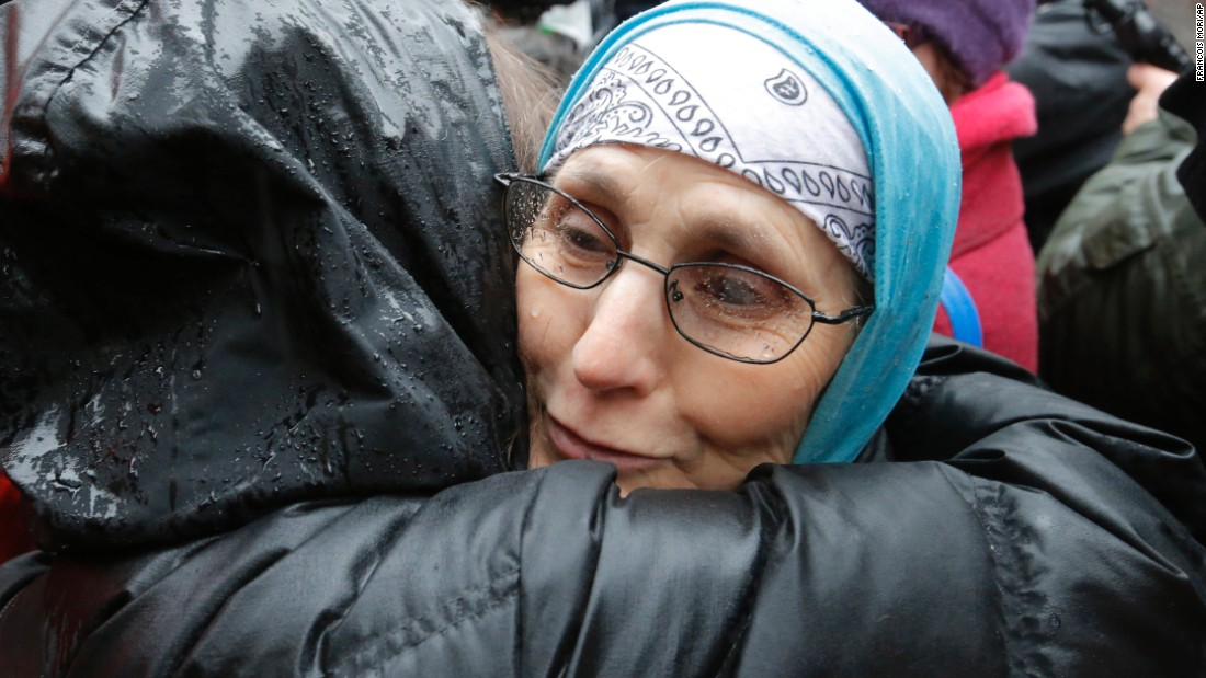 Women hug each other during a solidarity rally outside the office of Charlie Hebdo on January 8.