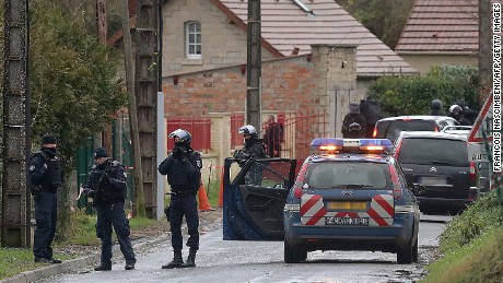 "Members of GIPN and of RAID, French police special forces, are pictured in Corcy, near Villers-Cotterets, north-east of Paris, on January 8, 2015, where the two armed suspects from the attack on French satirical weekly newspaper Charlie Hebdo were spotted in a gray Clio. French security forces deployed on January 8 in a northern town where two brothers suspected of having gunned down 12 people in an Islamist attack on satirical magazine Charlie Hebdo abandoned their car, a police source said. Cherif Kouachi, 32, a jihadist well-known to police, and his brother Said, 34, were spotted by the manager of a petrol station in the town about an hour's drive northeast of Paris, who after being robbed ""formally identified"" the two men. AFP PHOTO / FRANCOIS NASCIMBENI        (Photo credit should read FRANCOIS NASCIMBENI/AFP/Getty Images)"