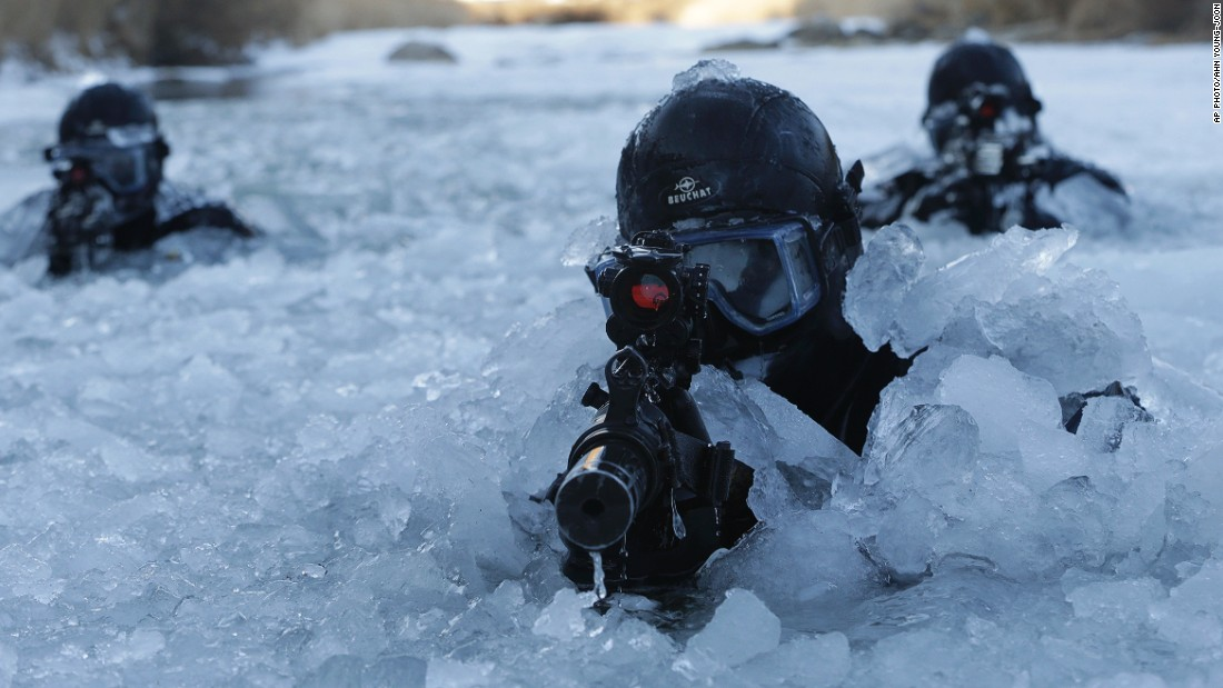 JANUARY 8 - PYEONGCHANG, SOUTH KOREA: South Korea's Army Special Warfare Command (SWC) soldiers aim their machine guns in a frozen river during a winter exercise. About 200 SWC soldiers participated in this routine drill that lasts for two weeks.