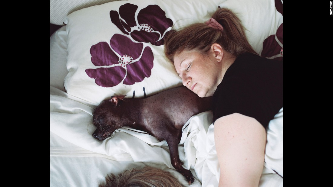 Every night, Mugly sleeps with his owner, Bev Nicholson.