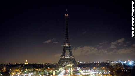 As a tribute for the victims of yesterday's terrorist attack the lights of the Eiffel Tower were turned off for five minutes at 8pm local time on January 8, 2015 in Paris, France. Twelve people were killed yesterday including two police officers as two gunmen opened fire at the offices of the French satirical publication Charlie Hebdo. on January 8, 2015 in Paris, France. (Photo by Aurelien Meunier/Getty Images)
