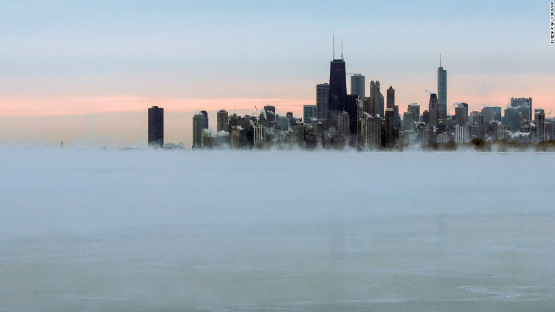 Steam rises over Lake Michigan near the Chicago skyline on Thursday, January 8. The National Weather Service predicted heavy rains and mountain snow in the Northwest and snow from the northern Plains to the northern Mid-Atlantic states.