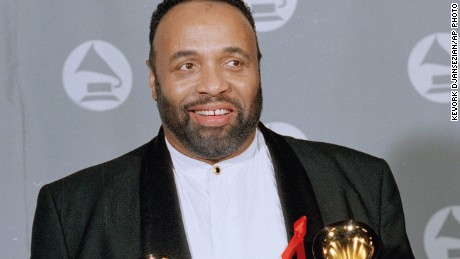 "In this March 1, 1995 file photo, Andrae Crouch displays his two Grammys backstage at the 37th annual Grammy Awards at the Shrine Auditorium in Los Angeles. Crouch won Pop-Contemporary Gospel Album for ""Mercy,"" and Instrumental Arrangement with Vocals for ""Circle of Life,"" with Lebo Morake and Hans Zimmer. Crouch, a legendary gospel performer, songwriter and choir director whose work graced songs by Michael Jackson and Madonna and movies such as ""The Lion King,"" has died at age 72. His publicist says Crouch died Thursday, Jan. 8, 2015, at a hospital in Los Angeles, where he was admitted Saturday after suffering a heart attack."