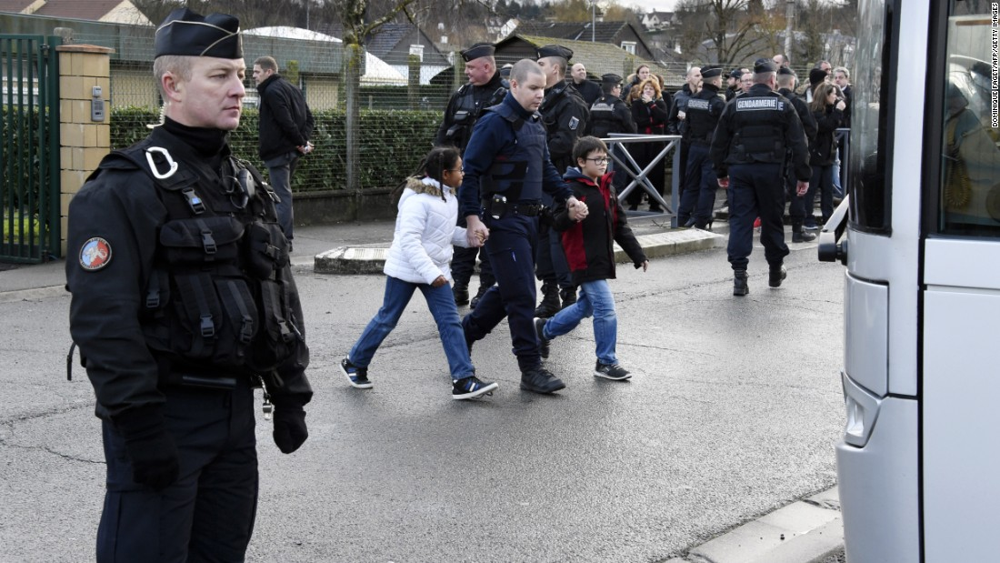 French gendarmes stand guard as a nearby school is evacuated in Dammartin-en-Goele on January 9.