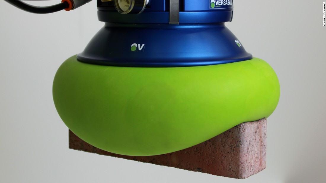 "<a href=""http://empirerobotics.com/#"" target=""_blank"">Empire Robotic's</a> Versaball is filled with a ""sand like material."" When air is pumped into the ball it softens, molding around an object, and then when air is removed, the green ball hardens and grips objects from bricks to ping pong balls."