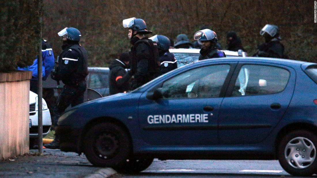 Police officers leave after storming the printing shop in Dammartin-en-Goele on January 9.