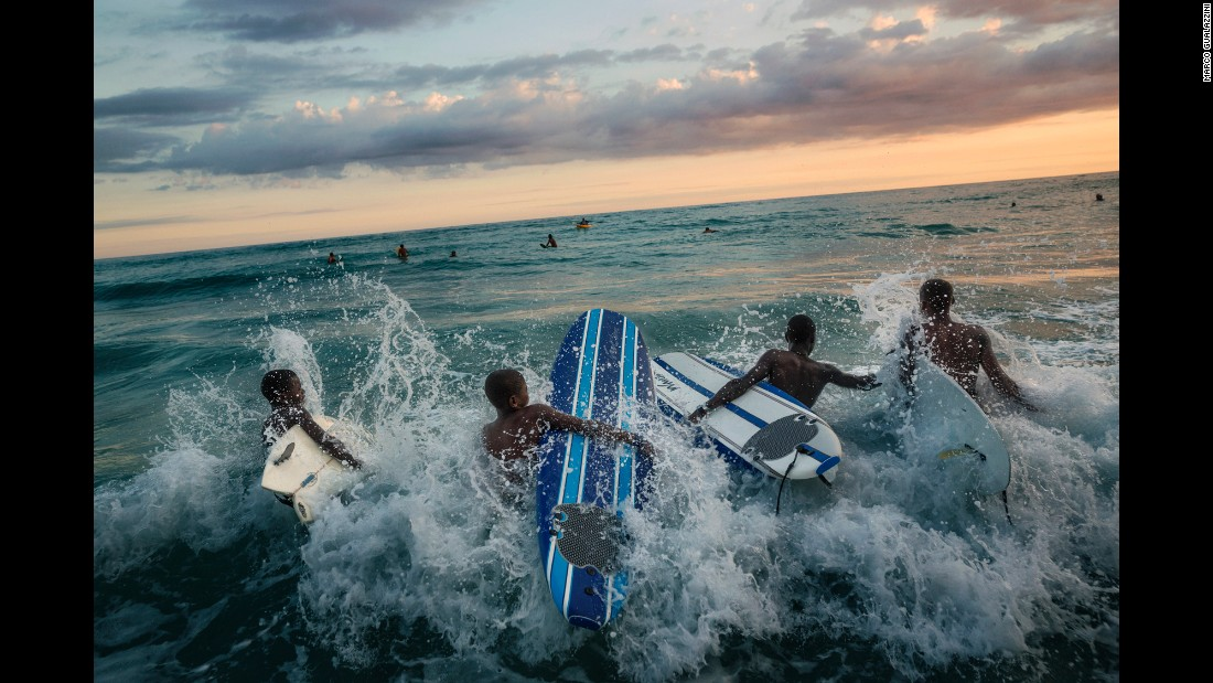 Children surf on the beaches of Jacmel, the province worst hit by the Haiti earthquake in January 2010. Photographer Marco Gualazzini recently visited the country to see how far it has come since the disaster.