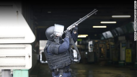A member of the police force aims as he mans a position at Porte de Vincennes, eastern Paris on January 9.