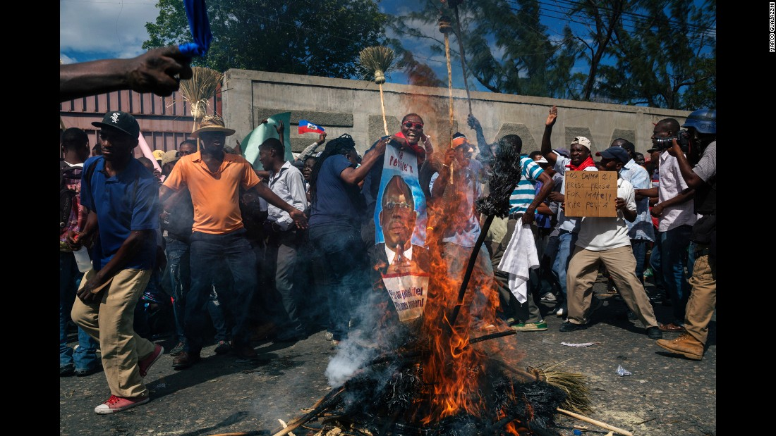 People protest against the government in the streets of Port-au-Prince.