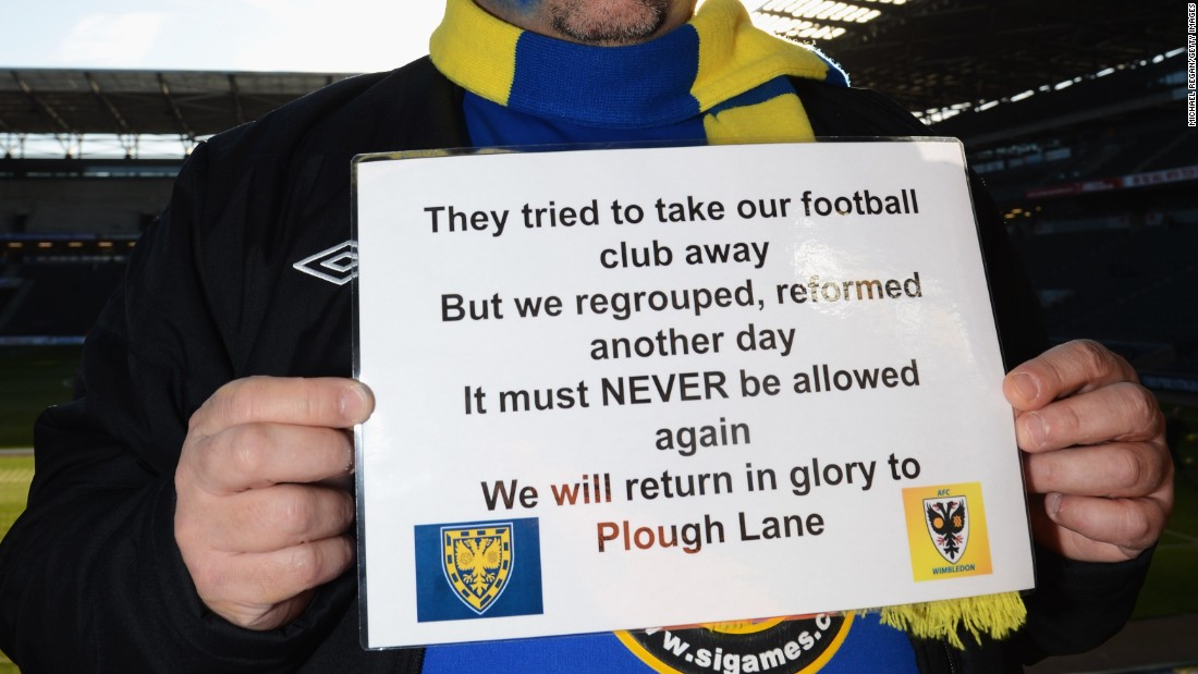 After the original Wimbledon were franchised out to Milton Keynes in 2012, supporters of the original club formed a new team: AFC Wimbledon. In 2012, an AFC fan holds up a placard ahead of the teams' clash in the FA Cup.