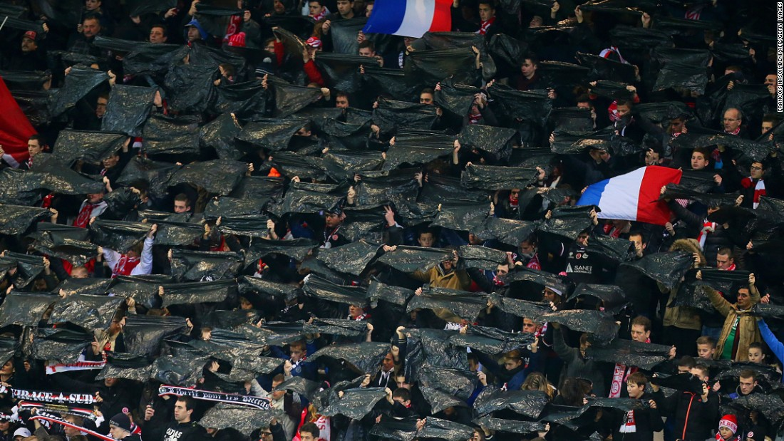 In the stands, Reims' supporters held black flags and the French tricolor aloft to mark their own tribute to the victims of this week's terror attacks.