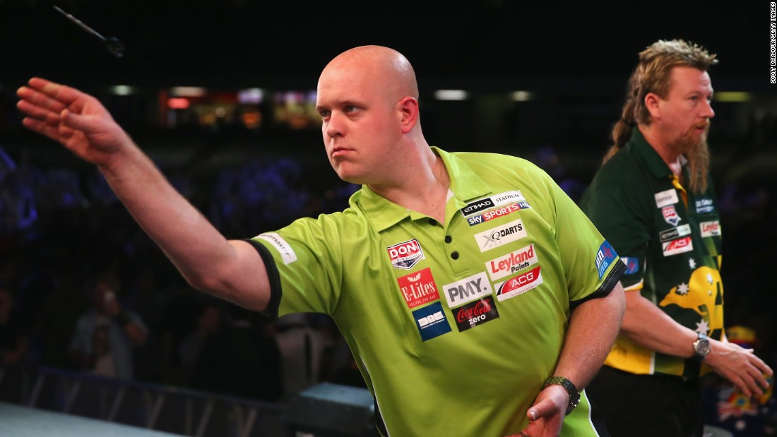 2014 world champion Michael van Gerwen of the Netherlands throws a dart on his way to beating Australia's Simon Whitlock in the final of the international event in Melbourne, which descended into chaos due to fan behavior.