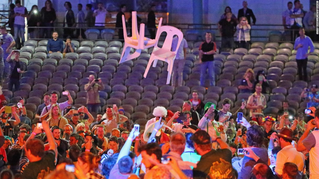 Plastic chairs were thrown in the air by the unruly crowd at the Etihad Stadium in Melbourne which appeared to encourage others to do the same.