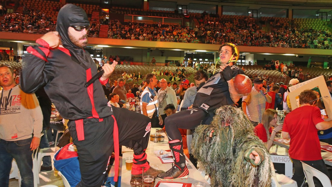 Revelers at the darts match were dressed in fancy dress and having a great time until the situation later turned ugly.