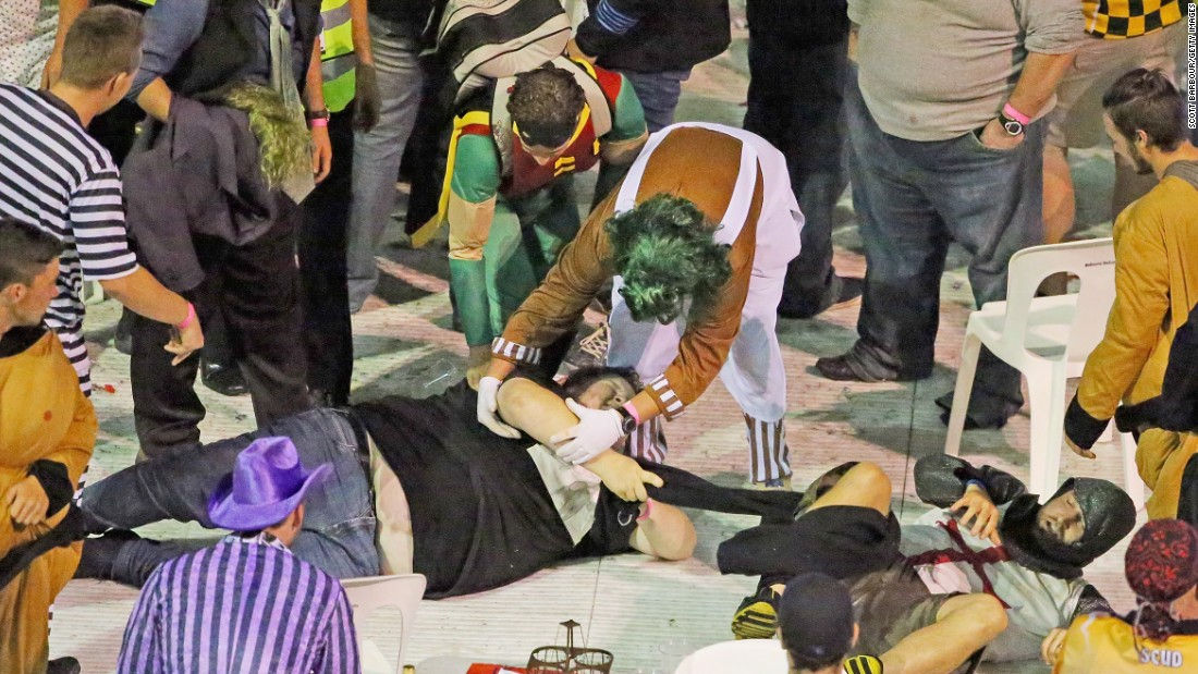 Fans in fancy dress ended up sprawled on the ground in the ensuing chaos as the crowd grew more unruly.