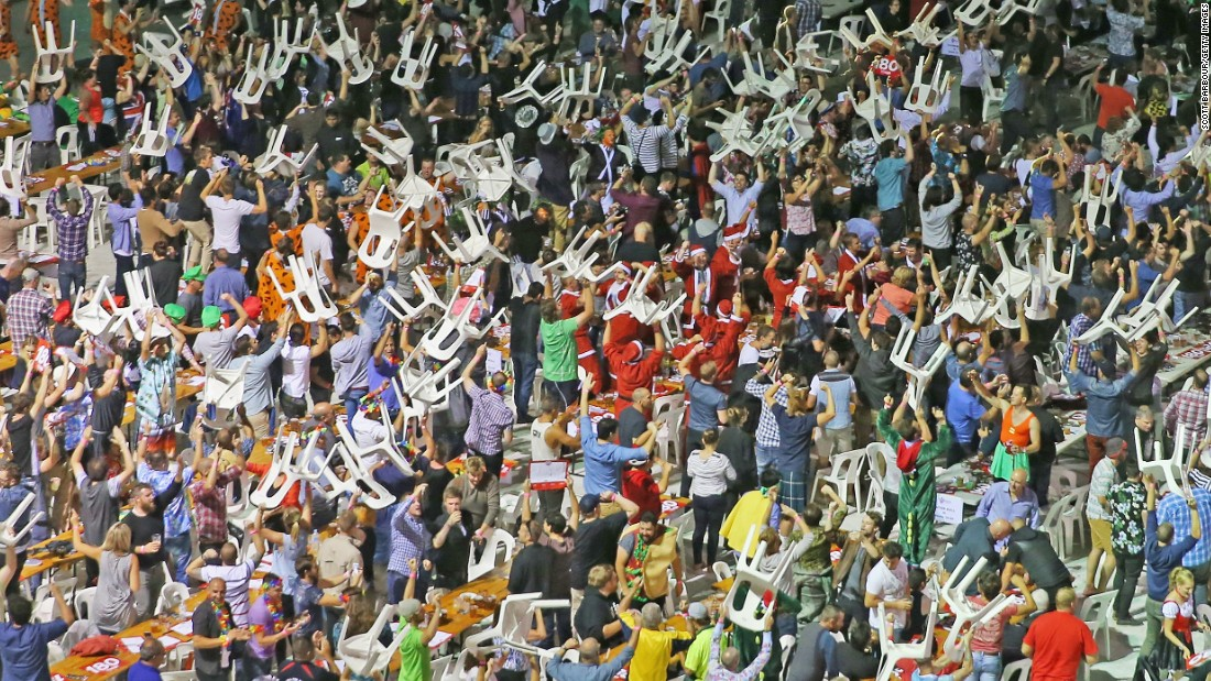 Spectators at an international darts match at the Etihad Stadium in Melbourne caused chaos as they started to throw their plastic chairs into the air.