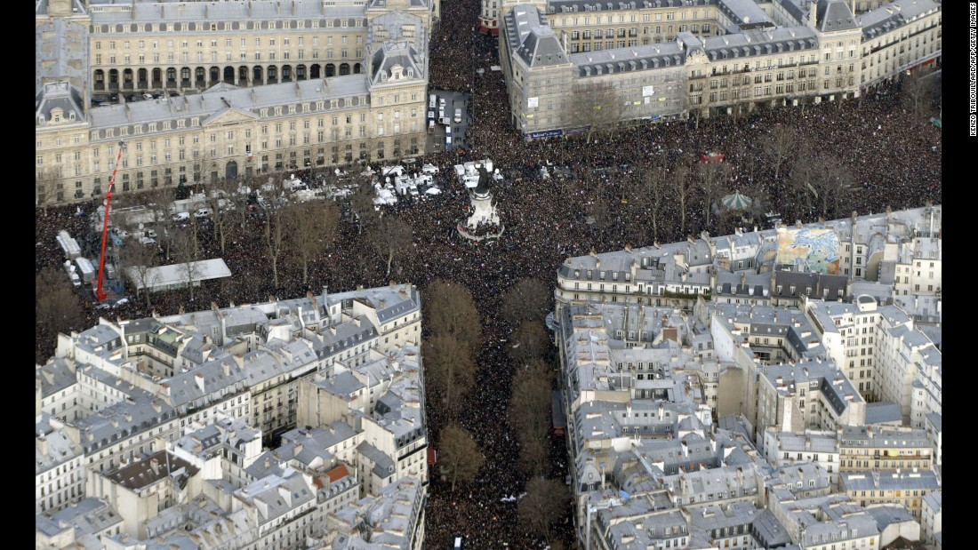 The massive crowd at the Place de la Republique is seen from above.