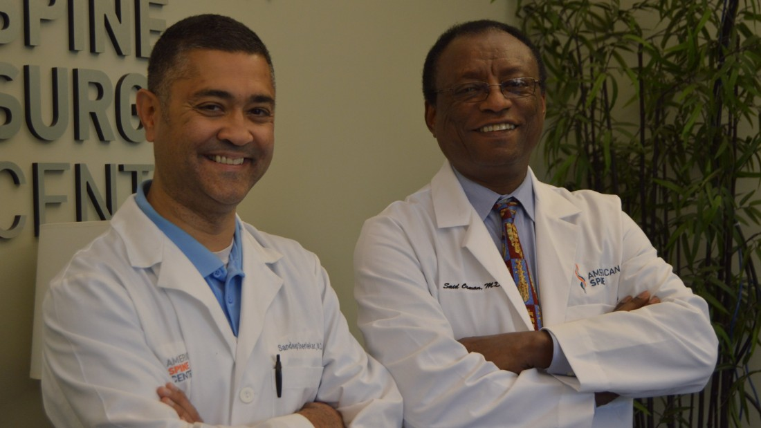 "Osman with his partner Sandeep Sherlekar at <a href=""http://www.americanspinemd.com/"" target=""_blank"">American Spine</a> in Frederick, Maryland."