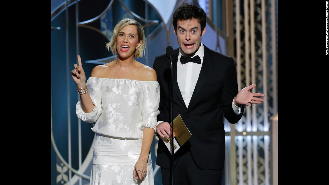 Kristen Wiig and Bill Hader present the award for best screenplay.