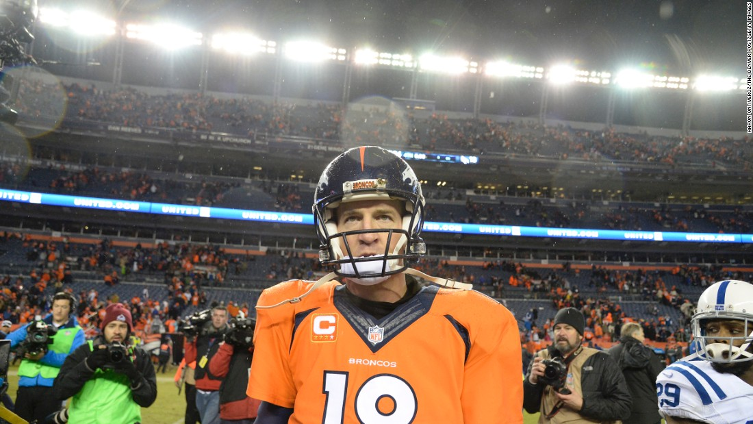 Denver Broncos quarterback Peyton Manning walks off the field after losing to his former team, the Indianapolis Colts, during a playoff game in Denver on Sunday, January 11.
