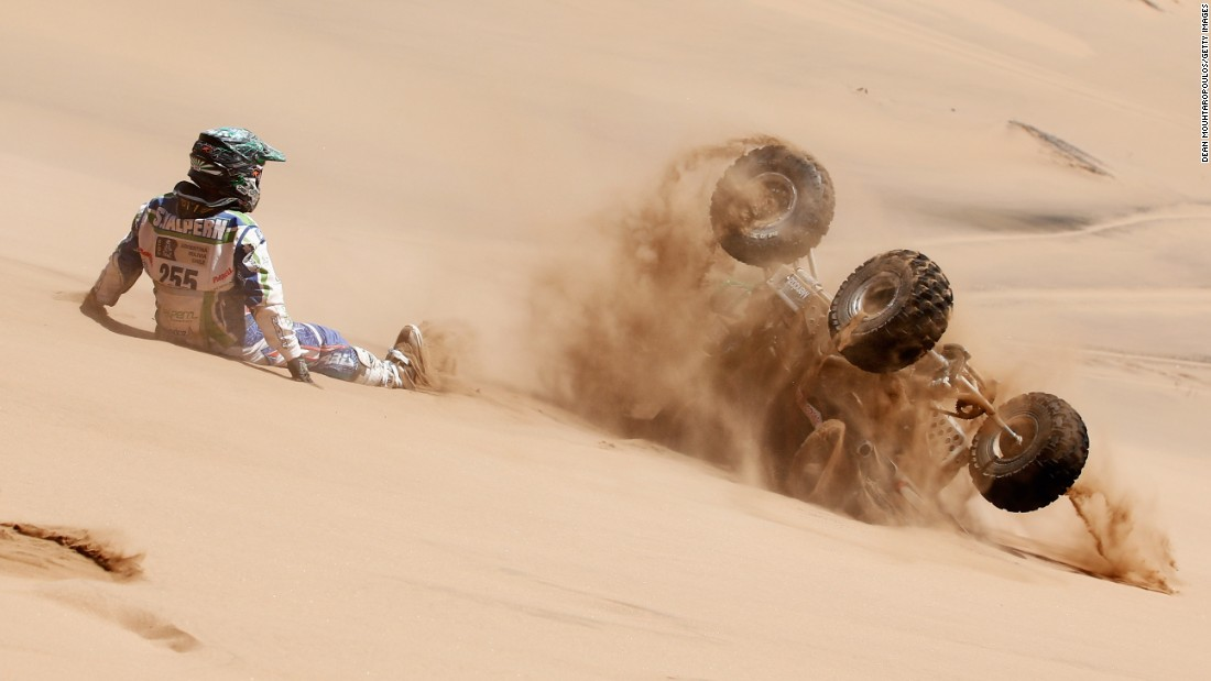 Sebastian Halpern watches his quad as it rolls down a sand dune Wednesday, January 7, during Day 4 of the Dakar Rally. The stage started in Chilecito, Argentina, and ended in Copiapo, Chile.