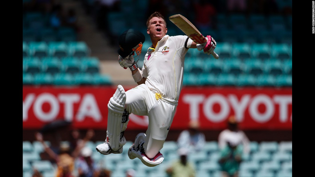 Australian cricket player David Warner celebrates a century while playing India in a Test match Tuesday, January 6, in Sydney. The match ended in a draw, but Australia won two matches earlier in the series.